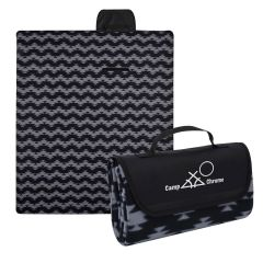 black and gray aztec patterned blanket that folds within itself and an imprint on the flap saying camp chrome