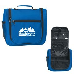 blue toiletry bag with side mesh pocket, zippered main compartment and a large front pocket