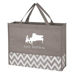 gray tote bag with a patterned design at the base with an imprint of a person playing the piano and text saying jazz festival