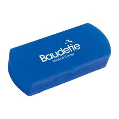blue pill holder and bandage dispenser with an imprint on top saying baudette medical center