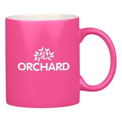 pink neon mug with a white inside and an imprint saying orchard environmental farming inc.
