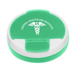 green and white circle pill holder with an imprint on top saying central healthcare institute with the medical symbol