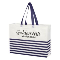 custom white and navy striped tote bag with navy handles and an imprint saying golden hill mariion hotel