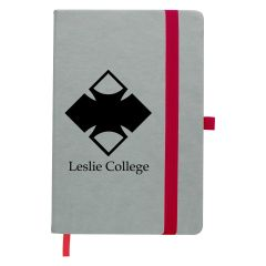 gray journal with red bookmark, strap closure, and pen holder and an imprint on the front saying leslie college