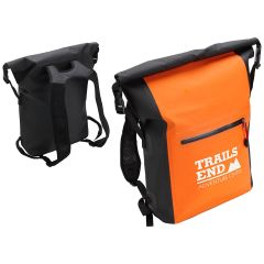 an orange dry bag backpack with a front pocket and an imprint saying Trails End Adventure Center